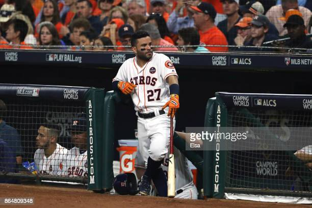 Jose Altuve of the Houston Astros looks on from the dugout against the New York Yankees during the third inning in Game Seven of the American League...