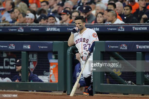 Jose Altuve of the Houston Astros looks on from the dugout during Game Three of the American League Championship Series against the Boston Red Sox at...