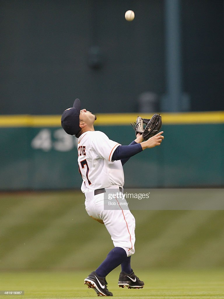 Jose Altuve #27 of the Houston Astros makes a catch in the second inning against the New York Yankees at Minute Maid Park on April 1, 2014 in Houston, Texas.