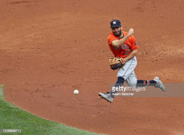Jose Altuve of the Houston Astros makes the throw to first base for the out against the Minnesota Twins during Game Two of the American League...