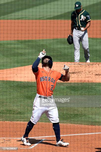 Jose Altuve of the Houston Astros points to the sky after hitting a solo home run against Jesus Luzardo of the Oakland Athletics during the first...