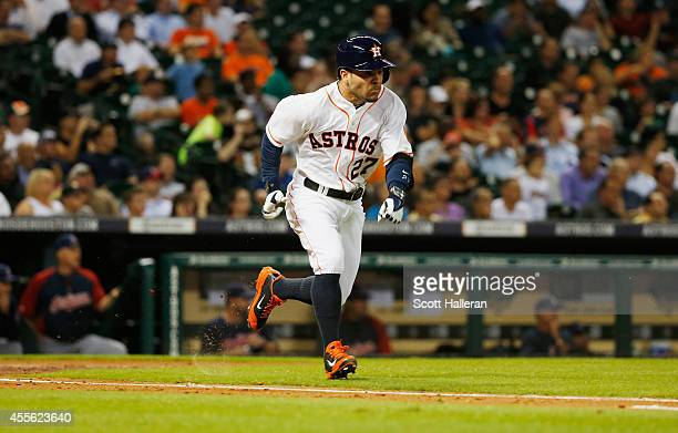 Jose Altuve of the Houston Astros reaches base on an infield single during the fourth inning against the Cleveland Indians during their game at...