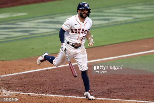 Jose Altuve of the Houston Astros reacts after a line drive out during the eighth inning against the Tampa Bay Rays in Game Five of the American...