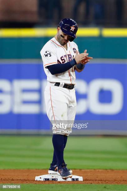 Jose Altuve of the Houston Astros reacts after a RBI double dyi against the Los Angeles Dodgers in game five of the 2017 World Series at Minute Maid...