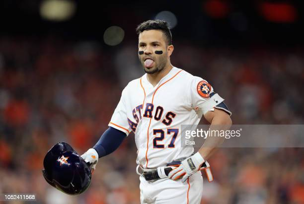 Jose Altuve of the Houston Astros reacts after flying out due to fan interference in the first inning against the Boston Red Sox during Game Four of...