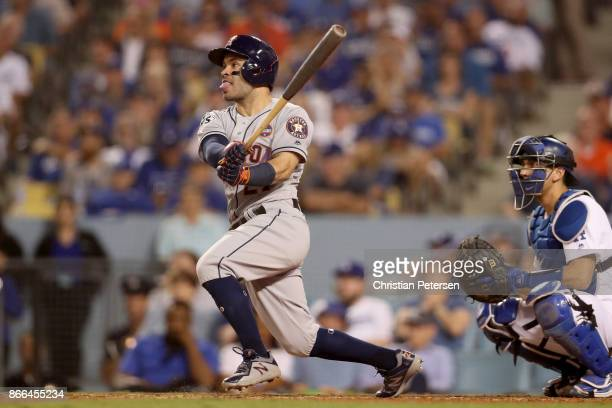 Jose Altuve of the Houston Astros reacts after hitting a solo home run during the tenth inning against the Los Angeles Dodgers in game two of the...