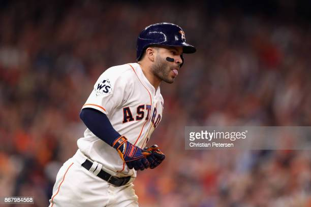 Jose Altuve of the Houston Astros reacts after hitting a threerun home run during the fifth inning against the Los Angeles Dodgers in game five of...