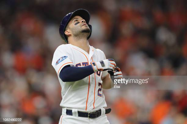 Jose Altuve of the Houston Astros reacts after lining out in the eighth inning against the Boston Red Sox during Game Five of the American League...