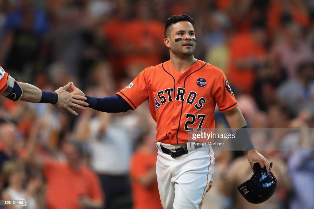 Jose Altuve #27 of the Houston Astros reacts after scoring a run in the sixth inning against the Boston Red Sox during game two of the American League Division Series at Minute Maid Park on October 6, 2017 in Houston, Texas.