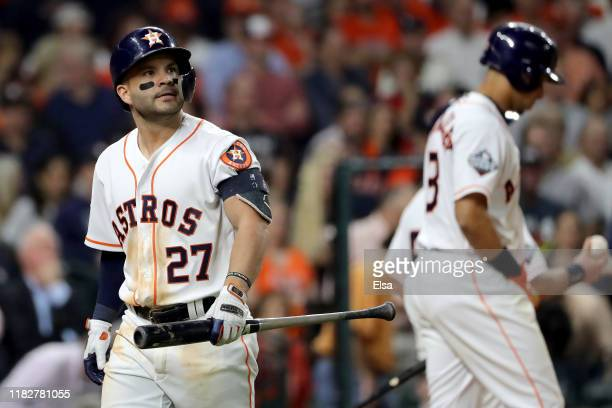 Jose Altuve of the Houston Astros reacts after striking out against the Washington Nationals during the seventh inning in Game One of the 2019 World...
