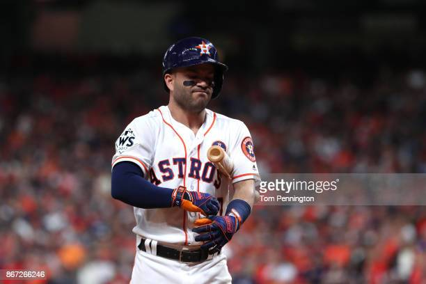 Jose Altuve of the Houston Astros reacts after striking out during the eighth inning against the Los Angeles Dodgers in game three of the 2017 World...