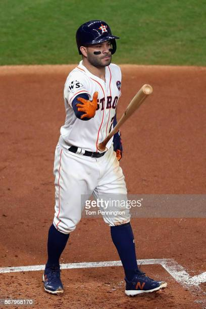 Jose Altuve of the Houston Astros reacts after striking out during the first inning against the Los Angeles Dodgers in game five of the 2017 World...