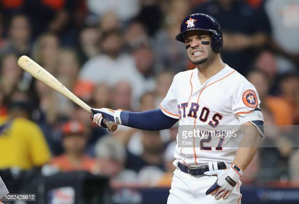 Jose Altuve of the Houston Astros reacts as he bats in the fourth inning against the Boston Red Sox during Game Four of the American League...