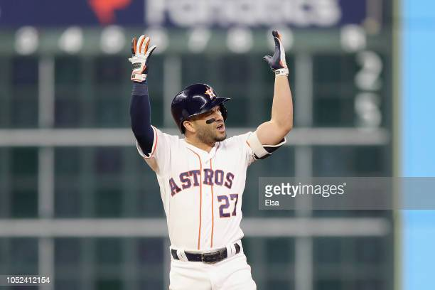 Jose Altuve of the Houston Astros reacts at second base after being called out due to fan interference in the first inning against the Boston Red Sox...