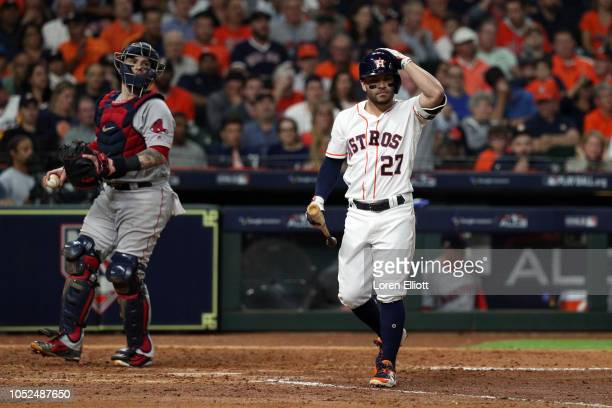 Jose Altuve of the Houston Astros reacts to striking out during Game 5 of the ALCS against the Boston Red Sox at Minute Maid Park on Thursday October...