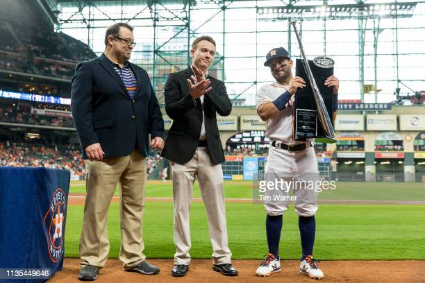 Jose Altuve of the Houston Astros receives the 2018 Silver Slugger Award prior to the game against the Oakland Athletics at Minute Maid Park on April...