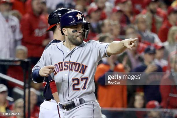 Jose Altuve of the Houston Astros rounds celebrates after he scores a run on a hit by Alex Bregman against the Washington Nationals during the first...