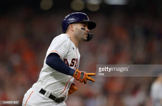 Jose Altuve of the Houston Astros rounds the bases after he hit a two-run home run in the sixth inning against the Boston Red Sox during Game One of...