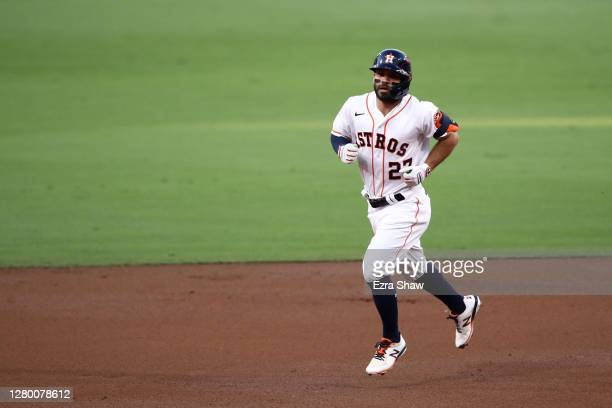 Jose Altuve of the Houston Astros rounds the bases after hitting a solo home run against the Tampa Bay Rays during the first inning in Game Three of...
