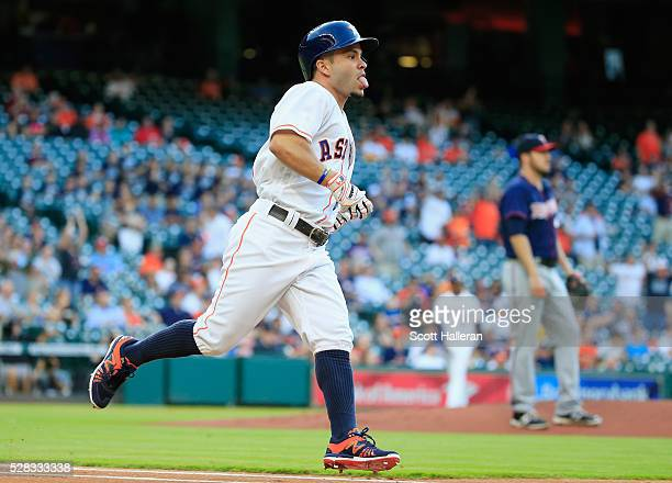 Jose Altuve of the Houston Astros rounds the bases after hitting a solo home run in the first inning off Phil Hughes of the Minnesota Twins during...