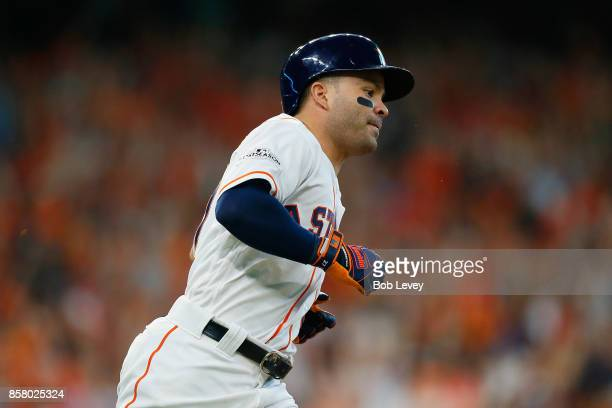 Jose Altuve of the Houston Astros runs the bases after hitting a home run in the fifth inning against the Boston Red Sox during game one of the...