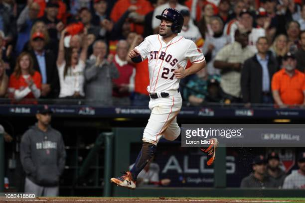 Jose Altuve of the Houston Astros scores a run in the third inning during Game 4 of the ALCS against the Boston Red Sox at Minute Maid Park on...