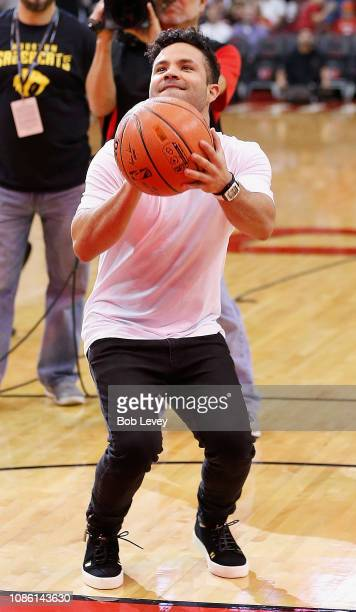 Jose Altuve of the Houston Astros shoots a free throw for Houston Rockets First Shot For Charity at Toyota Center on December 22 2018 in Houston...