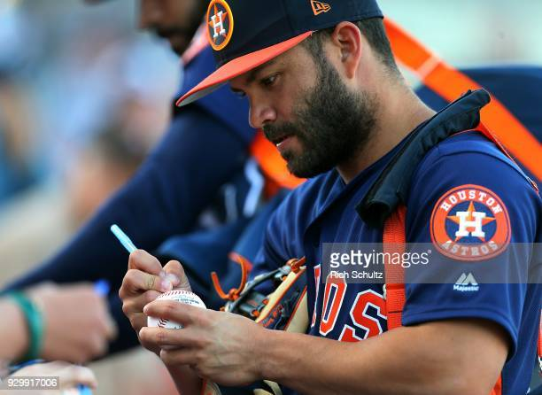 Jose Altuve of the Houston Astros signs autographs before a spring training game against the St Louis Cardinals at FITTEAM Ball Park of the Palm...
