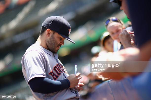 Jose Altuve of the Houston Astros signs autographs before their game against the Oakland Athletics at Oakland Alameda Coliseum on June 14 2018 in...