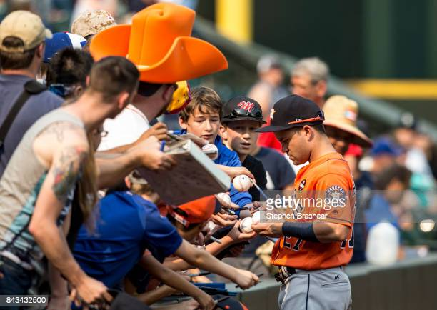 Jose Altuve of the Houston Astros signs autographs for fans before a game against the Seattle Mariners at Safeco Field on September 4 2017 in Seattle...