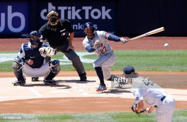 Jose Altuve of the Houston Astros singles during the first inning against Gerrit Cole of the New York Yankees at Yankee Stadium on May 06, 2021 in...
