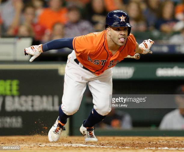 Jose Altuve of the Houston Astros singles in the eighth inning against the Detroit Tigers at Minute Maid Park on July 13 2018 in Houston Texas