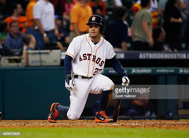 Jose Altuve of the Houston Astros sits at home plate during the ninth inning against the Cleveland Indians during their game at Minute Maid Park on...