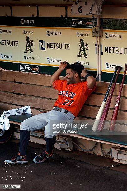 Jose Altuve of the Houston Astros sits in the dugout before the game against the Oakland Athletics at Oco Coliseum on August 7 2015 in Oakland...