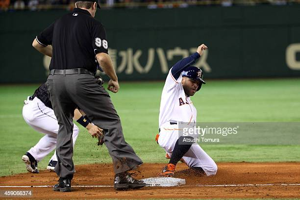 Jose Altuve of the Houston Astros slides into third base in the third inning during the game four of Samurai Japan and MLB All Stars at Tokyo Dome on...