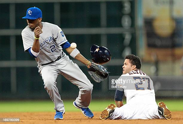 Jose Altuve of the Houston Astros slides safely into second base as Alcides Escobar of the Kansas City Royals cannot handle the throw in the eighth...