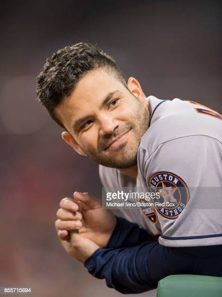 Jose Altuve of the Houston Astros smiles from the dugout during the ninth inning of a game against the Boston Red Sox at Fenway Park on September 29...
