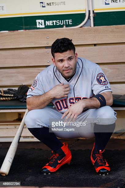 Jose Altuve of the Houston Astros squats in the dugout prior to the game against the Oakland Athletics at Oco Coliseum on September 9 2015 in Oakland...
