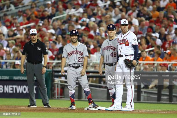 Jose Altuve of the Houston Astros stands on first base as Freddie Freeman of the Atlanta Braves looks on during the 89th MLB AllStar Game at...
