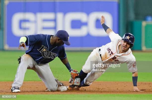 Jose Altuve of the Houston Astros steals second base as Adeiny Hechavarria of the Tampa Bay Rays is late with the tag in the first inning at Minute...