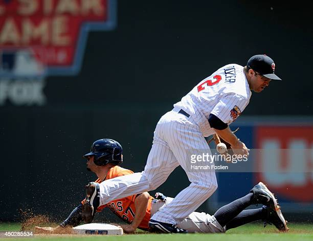 Jose Altuve of the Houston Astros steals second base as Brian Dozier of the Minnesota Twins fields the ball during the first inning of the game on...