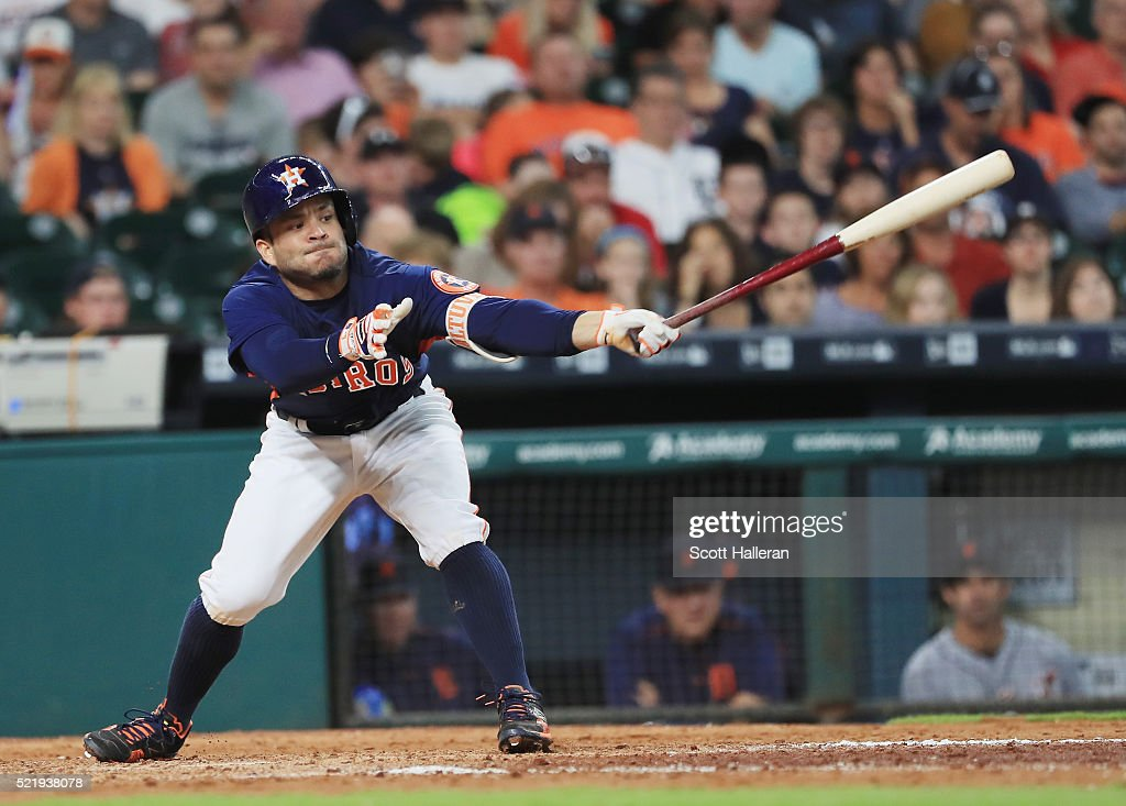 Jose Altuve #27 of the Houston Astros swings at a pitch during the sixth inning of their game against the Detroit Tigers at Minute Maid Park on April 17, 2016 in Houston, Texas.