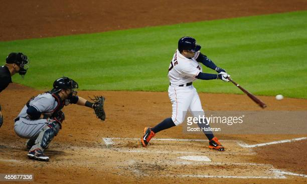 Jose Altuve of the Houston Astros swings at a pitch during the third inning against the Cleveland Indians during their game at Minute Maid Park on...