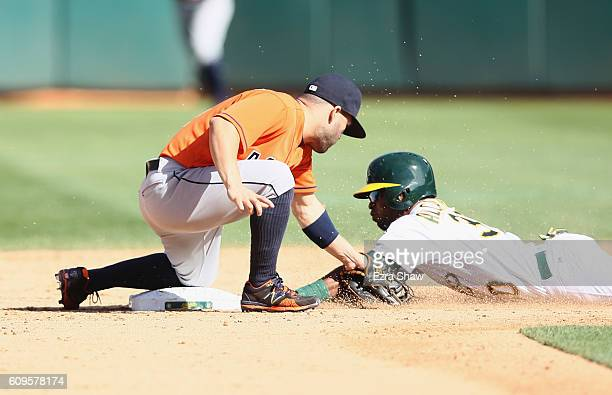 Jose Altuve of the Houston Astros tags out Arismendy Alcantara of the Oakland Athletics for the last out of the game when Alcantara tried to steal...