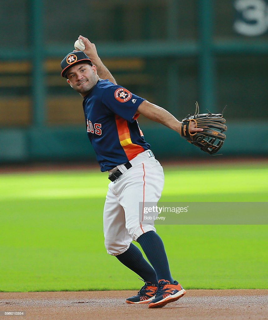 Jose Altuve #27 of the Houston Astros takes infield before playing the Tampa Bay Rays at Minute Maid Park on August 26, 2016 in Houston, Texas.