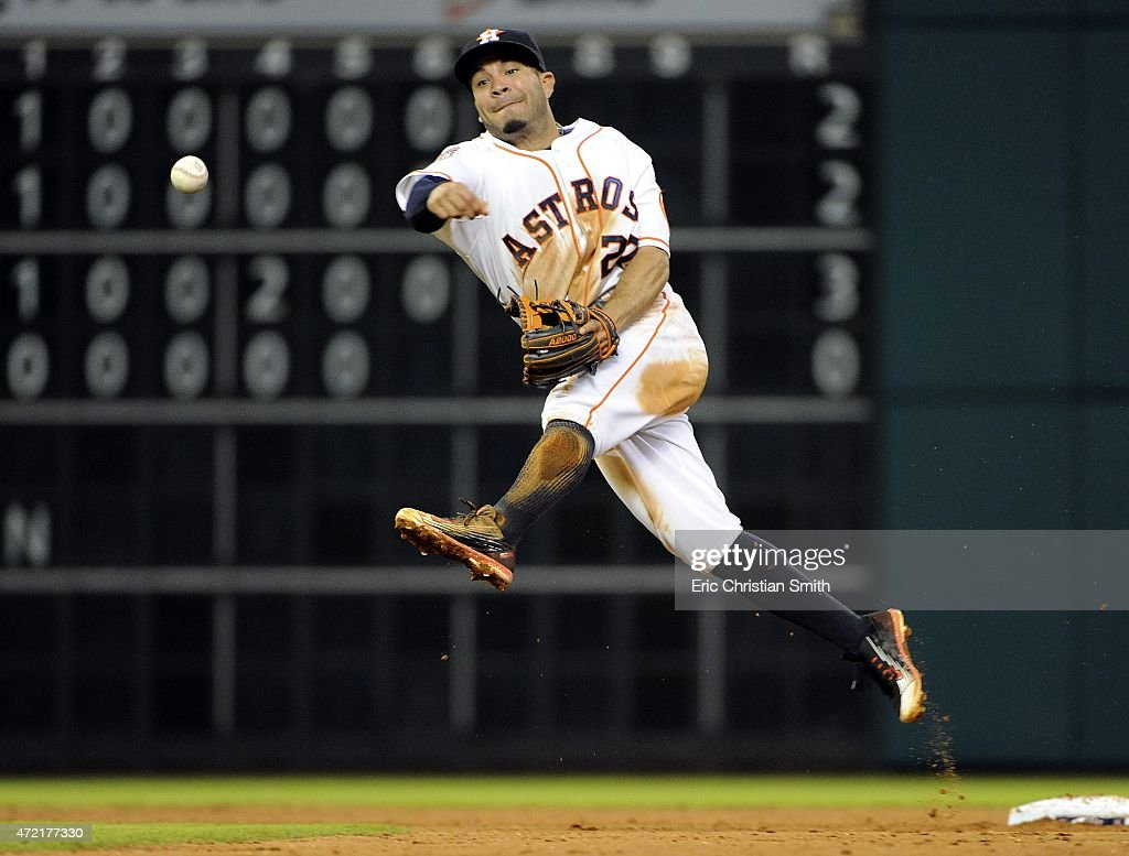 Jose Altuve #27 of the Houston Astros throws out Adam Rosales #9 (not shown) of the Texas Rangers during the fifth inning at Minute Maid Park on May 4, 2015 in Houston, Texas.