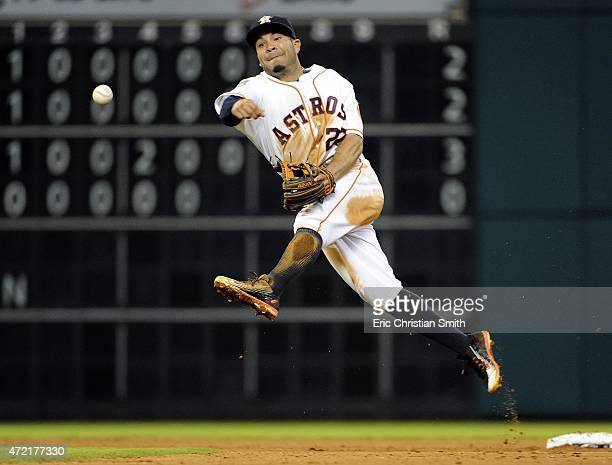 Jose Altuve of the Houston Astros throws out Adam Rosales of the Texas Rangers during the fifth inning at Minute Maid Park on May 4 2015 in Houston...
