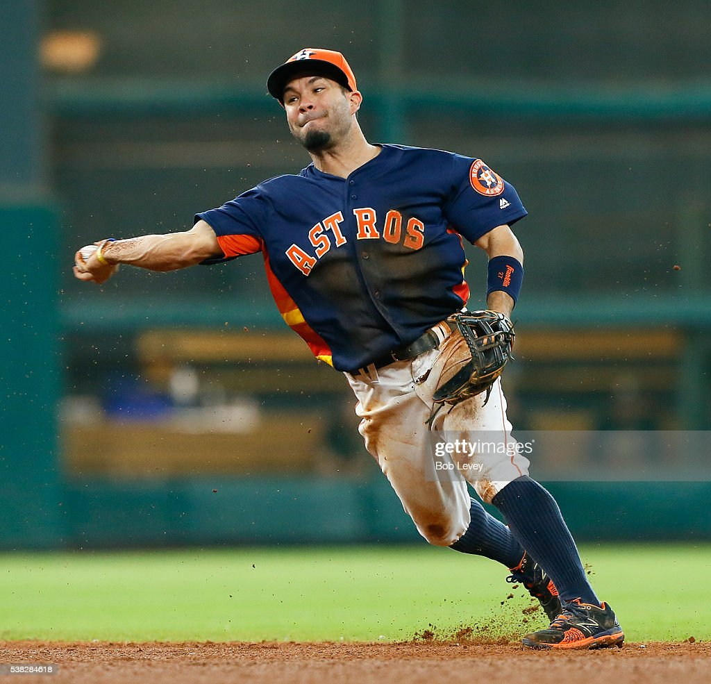 Jose Altuve #27 of the Houston Astros throws out Chris Coghlan #3 of the Oakland Athletics in the sixth inning at Minute Maid Park on June 5, 2016 in Houston, Texas.