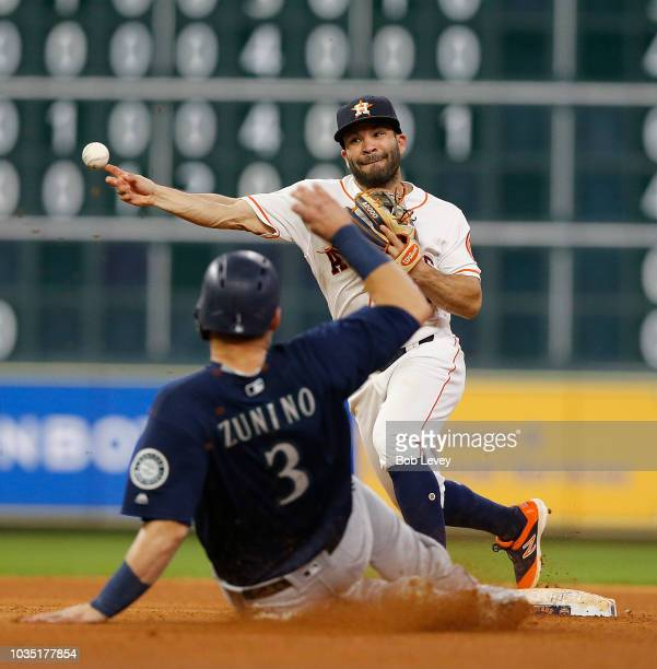 Jose Altuve of the Houston Astros throws over Mike Zunino of the Seattle Mariners in the seventh inning at Minute Maid Park on September 17 2018 in...