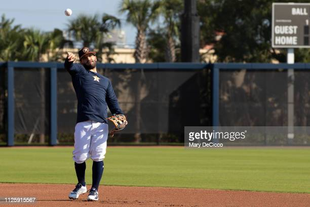 Jose Altuve of the Houston Astros throws the ball to first base during a spring training workout on Tuesday February 19 2019 at the FITTEAM Ballpark...